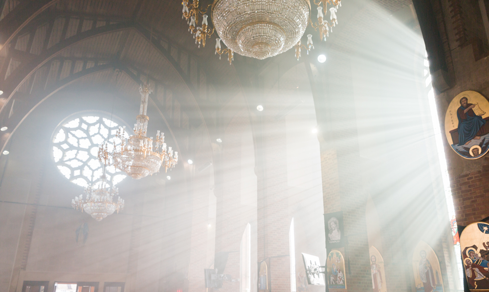 Sun rays illuminating the church during the Good Friday Service in St. Mary & Archangel Coptic Orthodox Church in London, UK